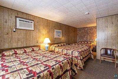 Three Queen Beds Motel Room